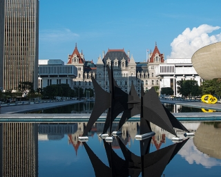 view of the empire state plaza reflecting pools facing the state capitol showing the calder sculpture