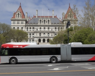 a CDTA bus stopped outside the New York State Capitol