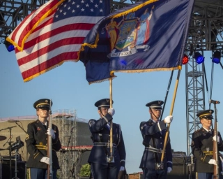 color guard holding new york state and american flags