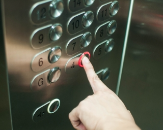 A person pressing an elevator button
