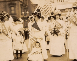 Youngest parade participant in New York City suffragist parade, c. 1912. Parades united women from varied backgrounds and received extensive news coverage.