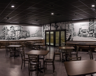 "View of the mural ""Ghost City Project"" in the Plaza food court."