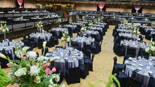 photo of the convention hall with round tables set up for dinner