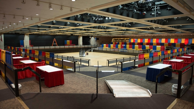 the convention hall with trade show booths set up