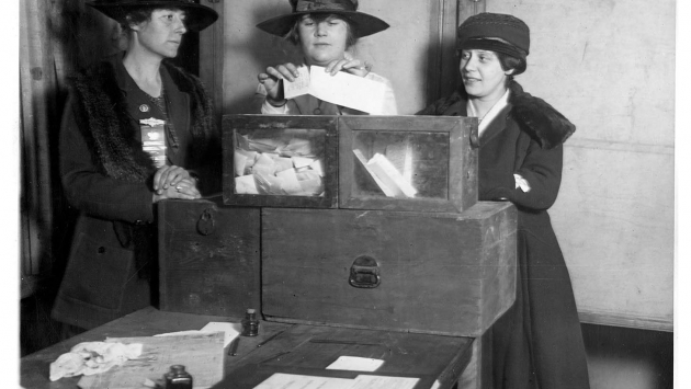 Three suffragists casting votes in New York City, c. 1920.
