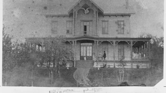 The mansion was originally built in 1856 for Albany businessman Thomas Olcott, seen here standing on the front porch.