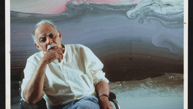 Portrait of Ed Clark in front of his artwork