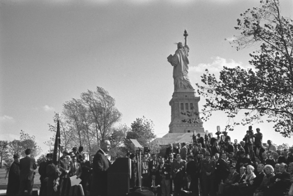 Lyndon B. Johnson delivers address on Liberty Island.
