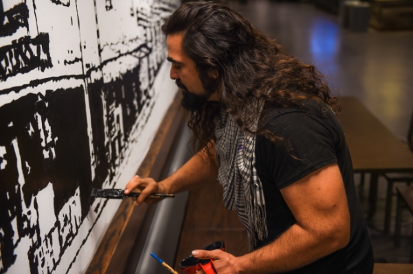 "Artist Samsom Contompasis paints ""Ghost City Project"" in the Empire State Plaza food court."